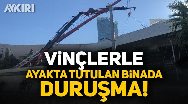 İzmir'de vinçlerle ayakta tutulan binada duruşma yapıldı