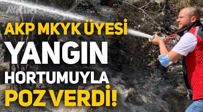 AKP MKYK üyesi Emre Ete, Manavgat'ta yangın hortumuyla poz verdi